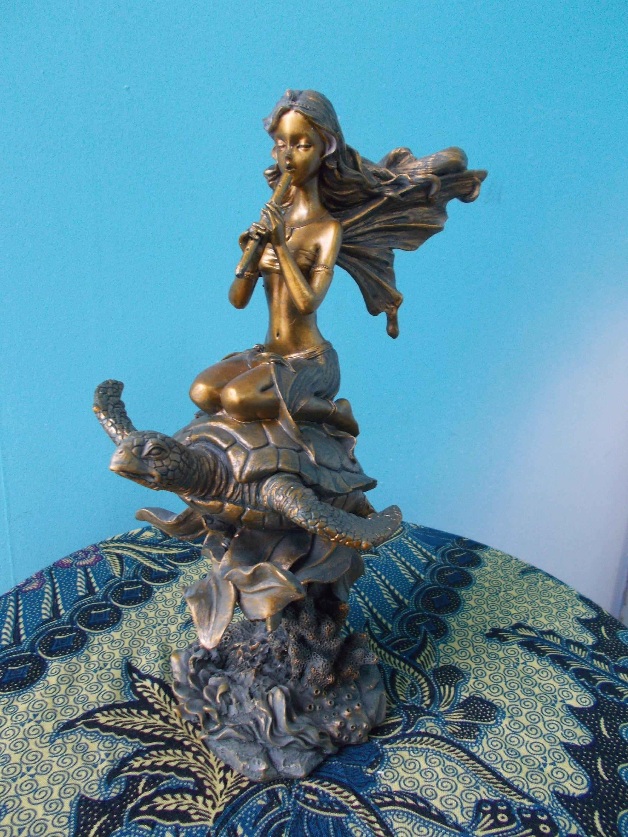 Fairy with Flute on Tortoise